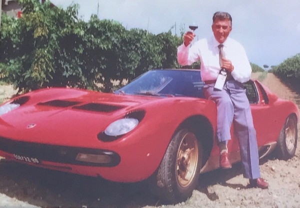 Man with Wine and Classic Lamborghini